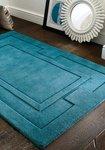 Effen vloerkleed zuiver wol Sera kleur turquoise
